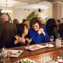 Two women eating at benefit for HB Studio, provider of acting classes in NYC