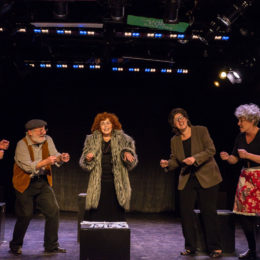 Seven actors onstage at HB Studio singing and dancing