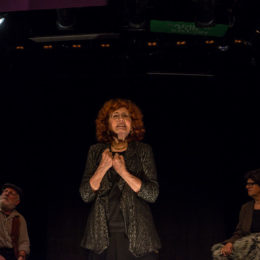 A group of actors on stage at HB Studio, one of them, centre stage, holds her hands in fists close to her chest and looks pained