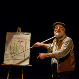 A man pointing to a plan with a stick onstage at HB Studio