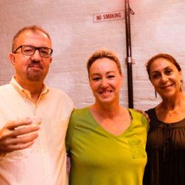 Three people arm in arm at HB Studio