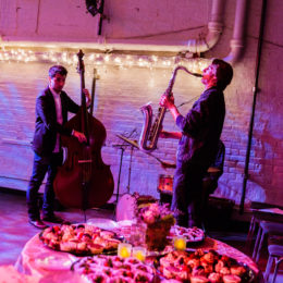 Musicians playing behind food plates
