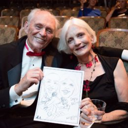 Two people with a drawing at 90th birthday celebration for Helen Gallagher, HB Studio teacher of Singing for the Musical Theater