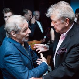 Two men conversing at 90th birthday celebration for Helen Gallagher, HB Studio teacher of Singing for the Musical Theater