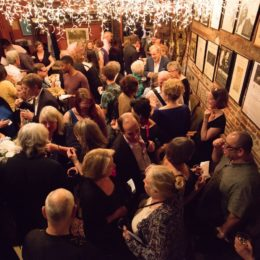 Crowd of people interacting at 90th birthday celebration for Helen Gallagher, HB Studio teacher of Singing for the Musical Theater