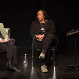 Dael Orlandersmith and Edith Meeks have a conversation on stage at HB theatre. They both cross their legs. There is only one bottle of water, whose is it?