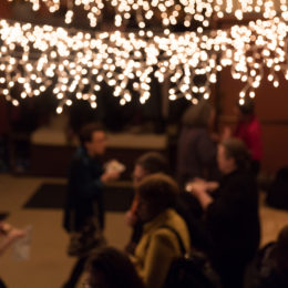 In the HB theatre people chat, interact, move, stand, eat and drink under pretty lights.