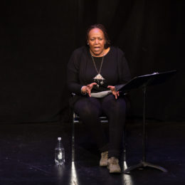 Dael Orlandersmith speaks to an audience with expressive hands