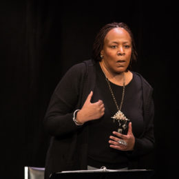 Dael Orlandersmith speaks to an audience with expressive hands at a benefit for HB Studio, provider of NYC acting classes