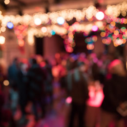 An ambient shot of a party, washed out and colorful.