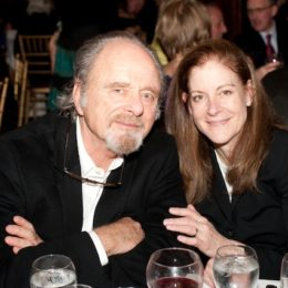 Two people at table at benefit for HB Studio, provider of acting classes in NYC