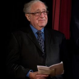 Man seated at benefit for HB Studio, provider of acting classes in NYC