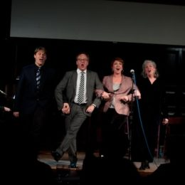 Pianist, and four performers singing and dancing onstage at benefit for HB Studio, provider of acting classes in NYC