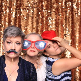 Theresa McElwee, Marion McCorry, and Sonia Mera having fun in the photo booth at the Uta Hagen at 100 Gala